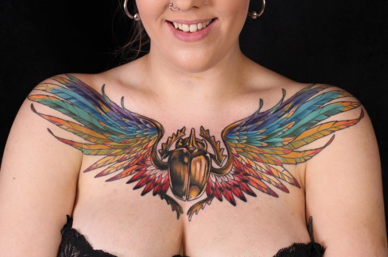 Coloured egyptian scarab with wings tattoo on chest