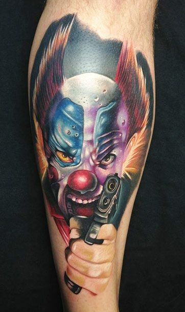 Coloured evil clown with a gun tattoo