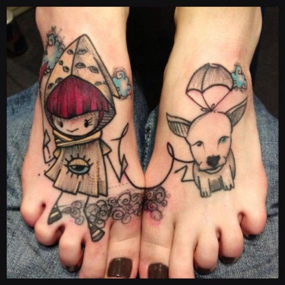 Coloured girl with dog tattoo on feet by Mope