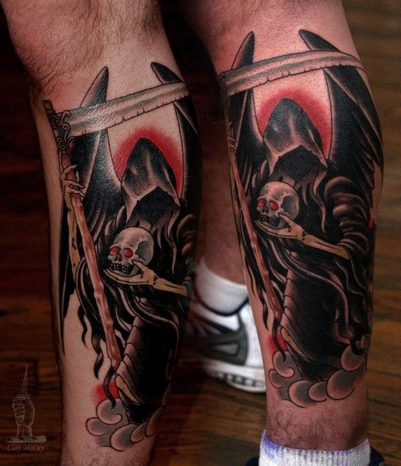 Coloured grim reaper with skull tattoo on  legs