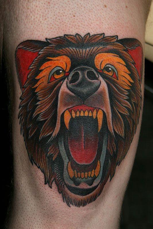 Coloured head snaling bear tattoo