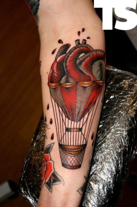 Coloured heart like a balloon tattoo by Kerry Anne
