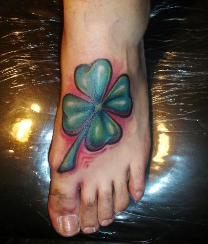 Coloured irish clover tattoo on foot