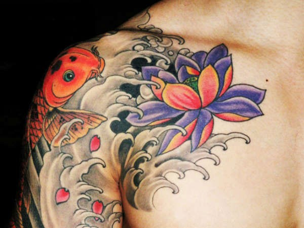 Coloured koi fish with lotus tattoo on shoulder