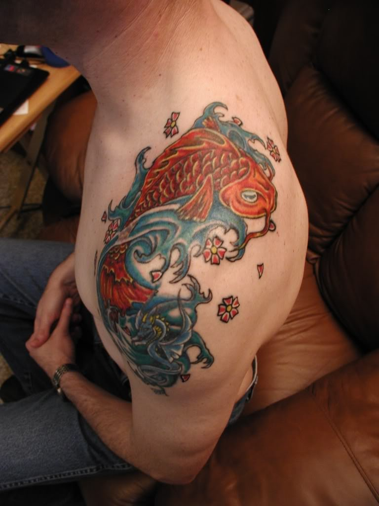 Coloured koi fish tattoo on shoulder