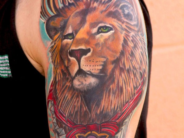 Coloured lion tattoo on shoulder
