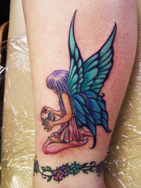 Coloured little fairy with skull tattoo