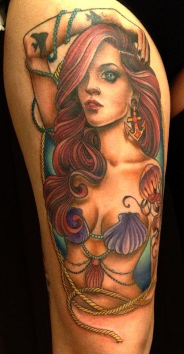 Coloured mermaid tattoo on thigh