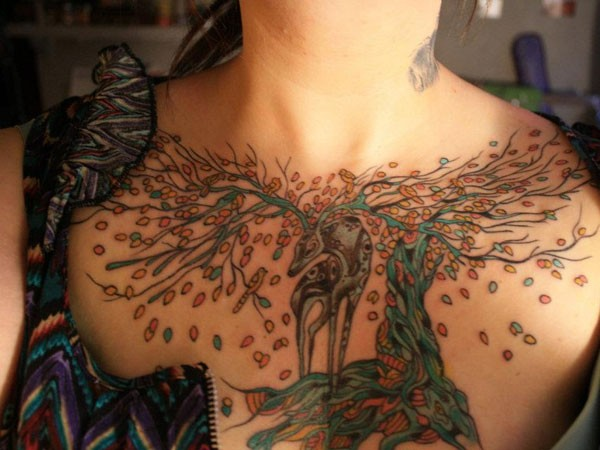 Coloured morphing deer tree tattoo on chest