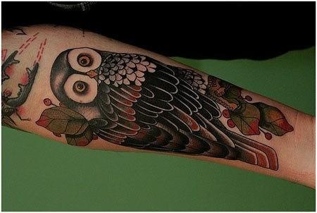 Coloured owl forearm tattoo