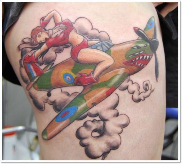 Coloured pin up aviatress girl tattoo on thigh