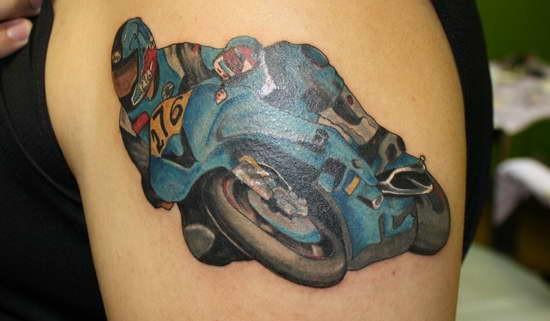 Coloured racer in bike tattoo on shoulder