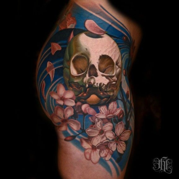 Coloured skull and cherry blossoms tattoo on shoulder