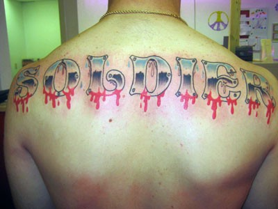 Coloured soldier tattoo on back