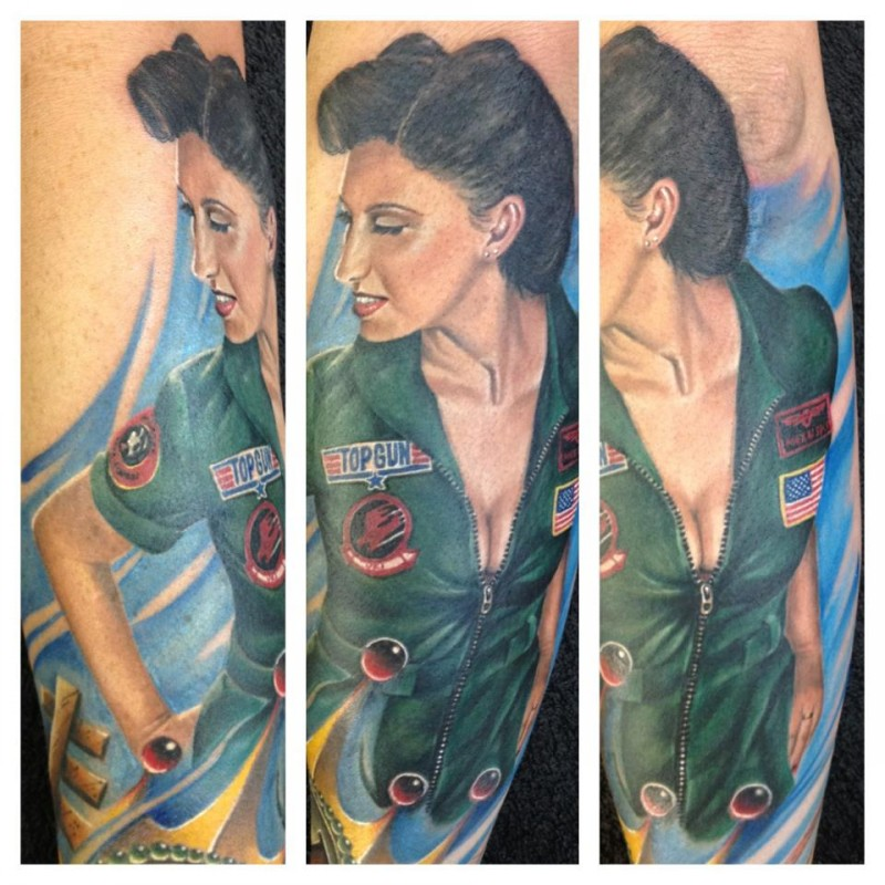 Coloured top gun pin up girl tattoo by Randy Engelhard