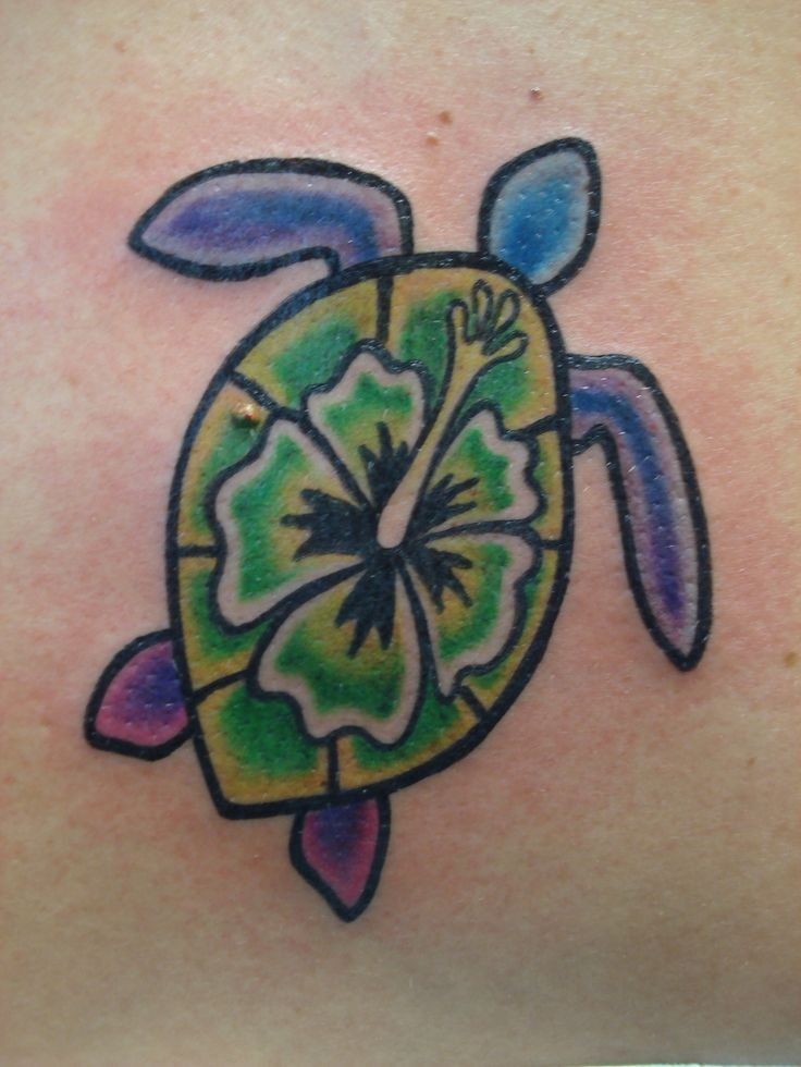 Coloured turtle with flower tattoo