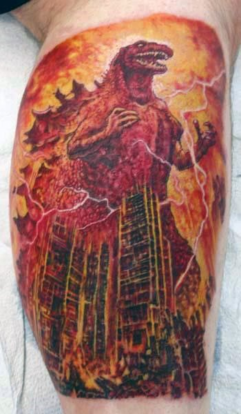 Comic books like colorful evil Godzilla in city tattoo on leg