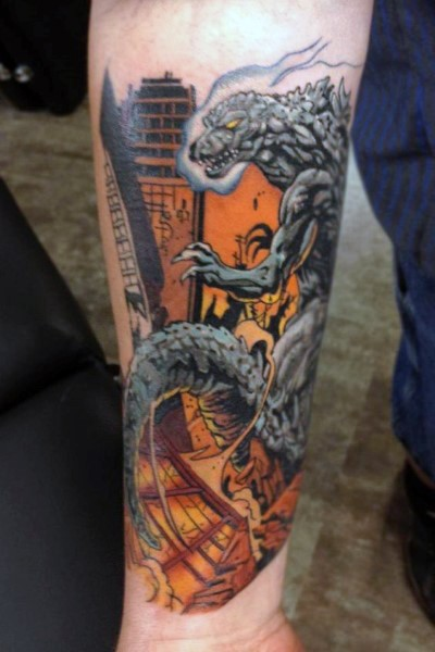 Comic books style colored evil Godzilla with burning city tattoo on arm