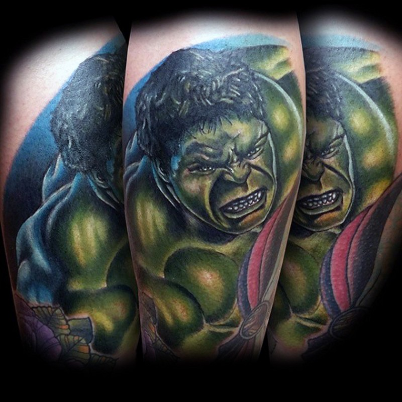 Comic books style colored forearm tattoo of Hulk and pink ribbon