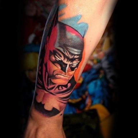 Comic books style colored forearm tattoo of Batman face