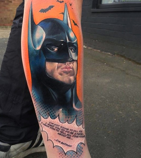 Comic books style colored leg tattoo of Batman and lettering