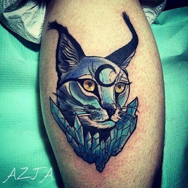 Comic books style colored leg tattoo of fantasy caracal with diamonds