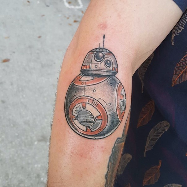 Comic books style colored little forearm tattoo of new droid