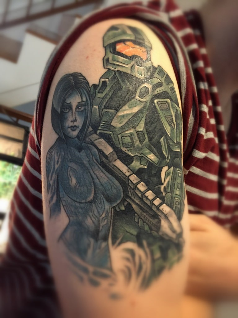 Comic books style colored shoulder tattoo of various video games heroes