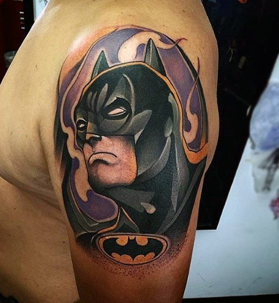 Comic books style colored shoulder tattoo of Batman face