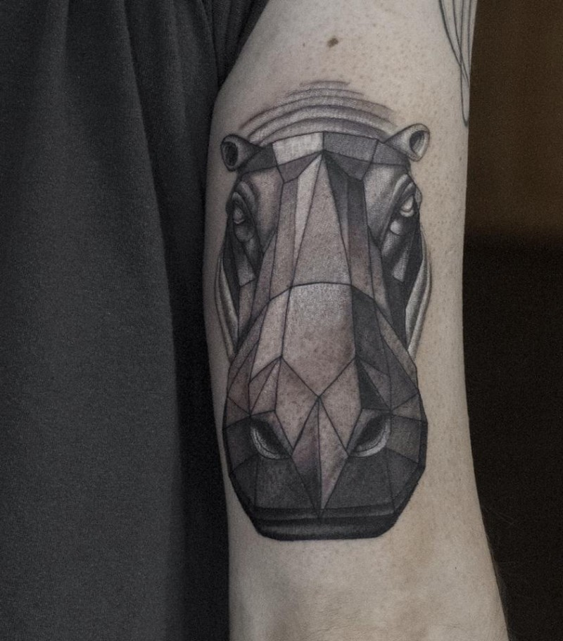 Cool abstract gray-ink hippo tattoo on upper arm
