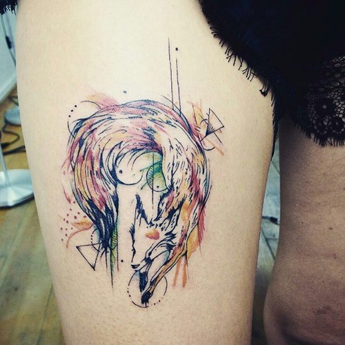 Cool abstract style colored thigh tattoo of fox with various geometrical figures