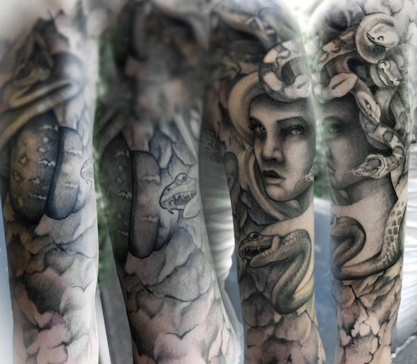 Cool and mystical black and white evil Medusa tattoo on sleeve