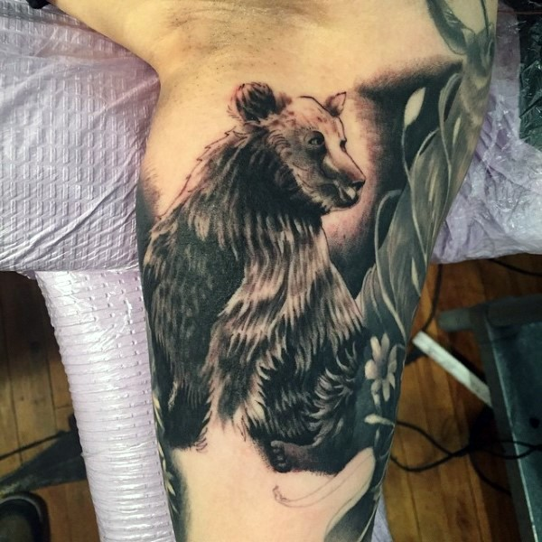 Cool black and white big bear tattoo on arm