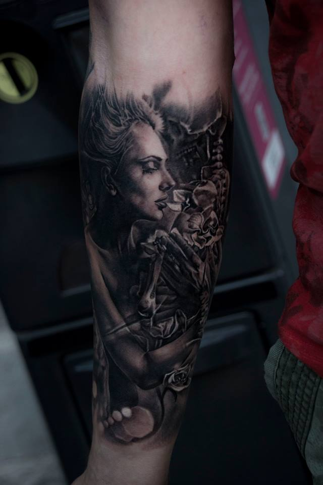 Cool black and white woman tattoo on forearm