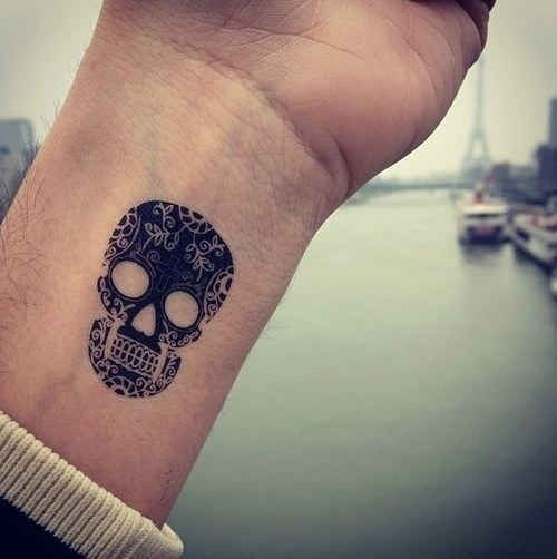 Cool black ink sugar skull wrist tattoo