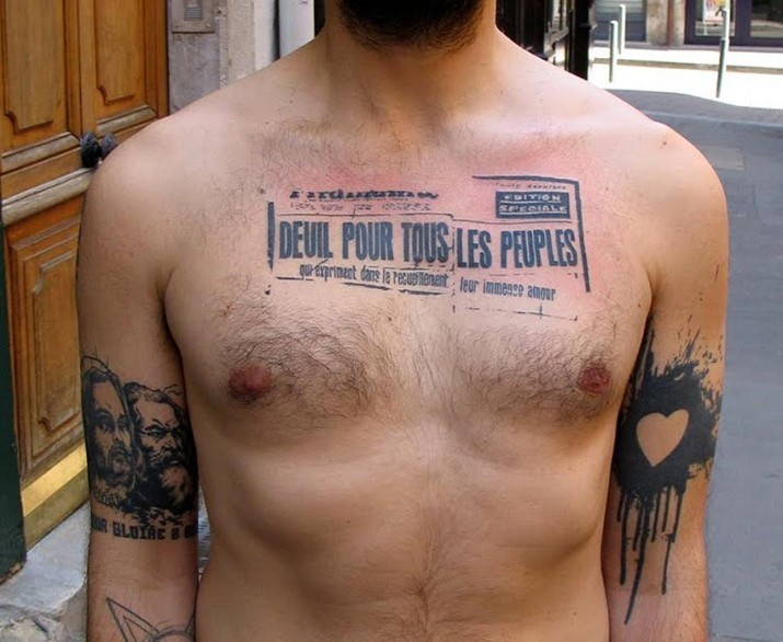 Cool black print tattoo on chest for men