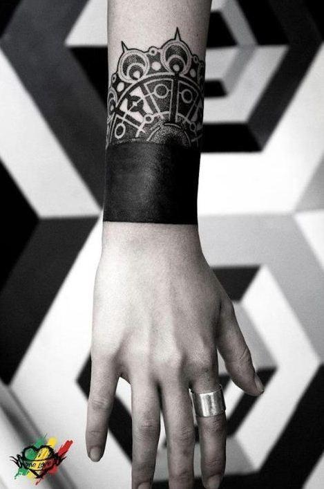 Cool blackwork wrist tattoo by Last Hope