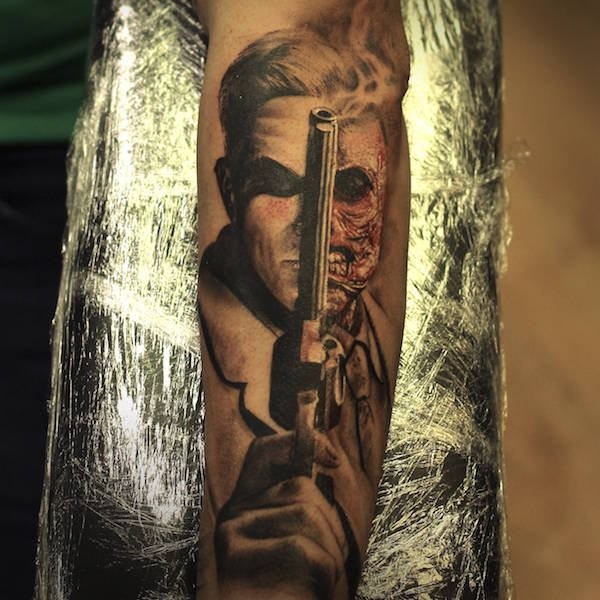 Cool breathtaking looking arm tattoo of half zombie half man with pistol