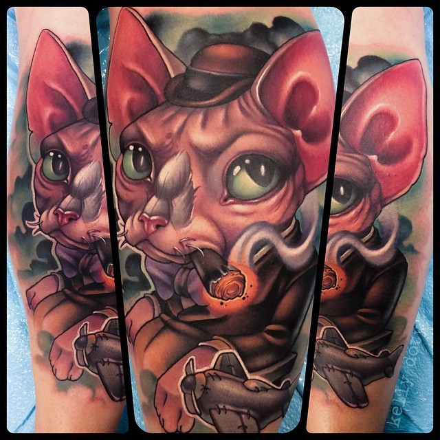 Cool cartoon like 3D style painted smoking gentleman cat tattoo on leg with tiny plane