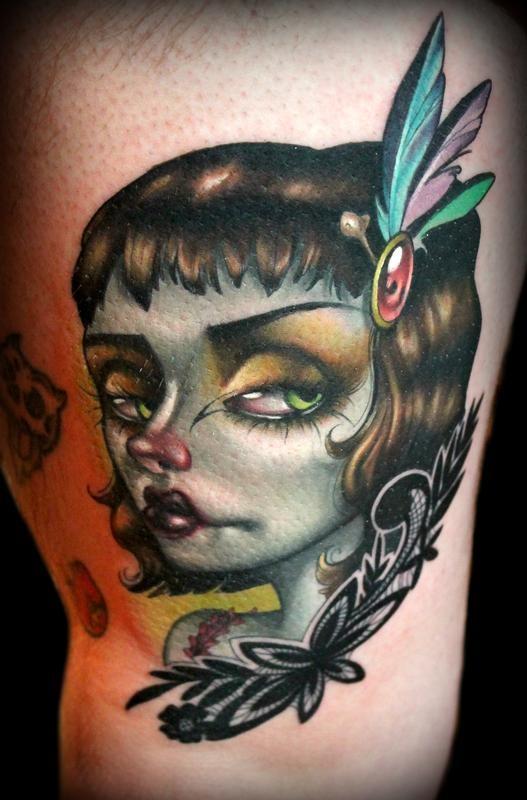 Cool cartoon like colored 3D thigh tattoo of creepy woman portrait