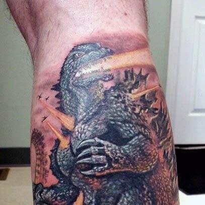 Cool cartoon like colored big Godzilla tattoo on leg