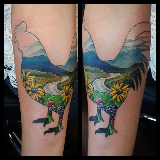 Cool cock shaped forearm tattoo stylized with beautiful countryside