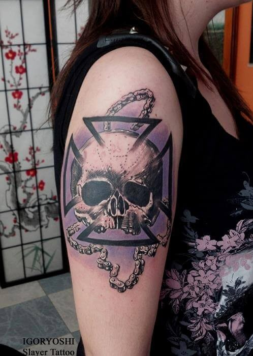 Cool colored human skull tattoo on shoulder with bicycle chain