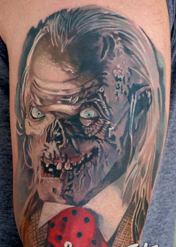 Cool colored very detailed monster portrait tattoo on arm