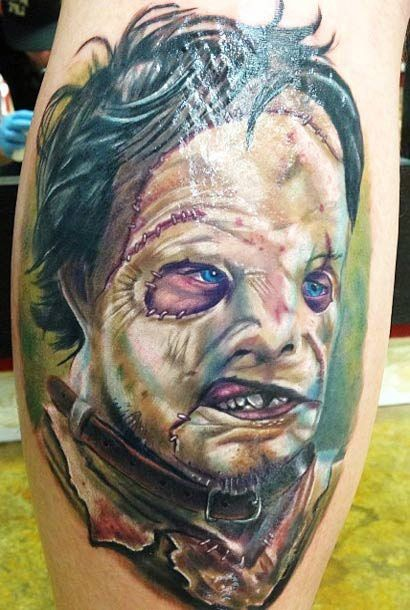 Cool colored very realistic monster portrait tattoo on leg