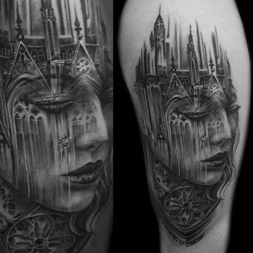 fresco combinazione grande bianco e nero stilizzato con vecchia citta medievale tatuaggio su spalla