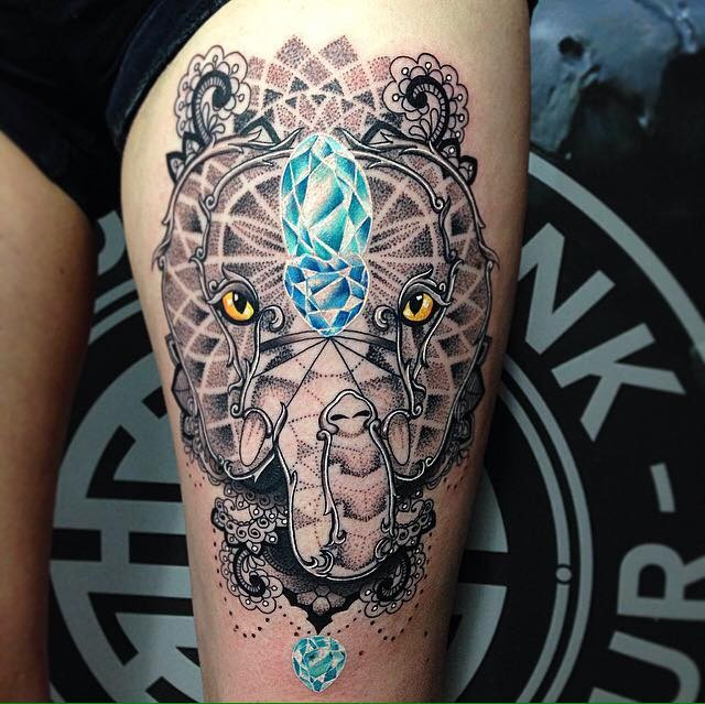 Cool combined stippling style elephant tattoo on thigh with big blue diamonds