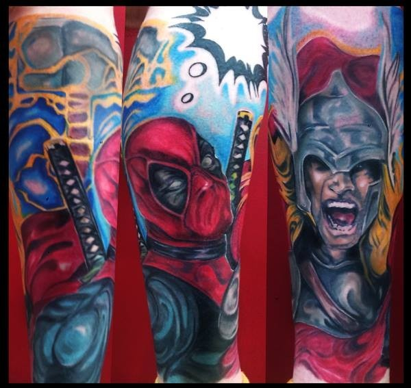 Cool comic books colored forearm tattoo of Deadpool and Thor