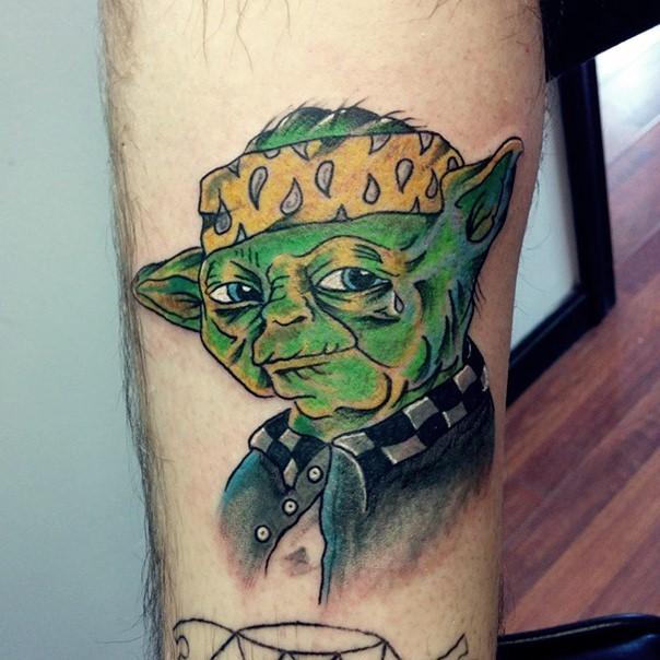 Cool comic books Yoda portrait tattoo on leg zone