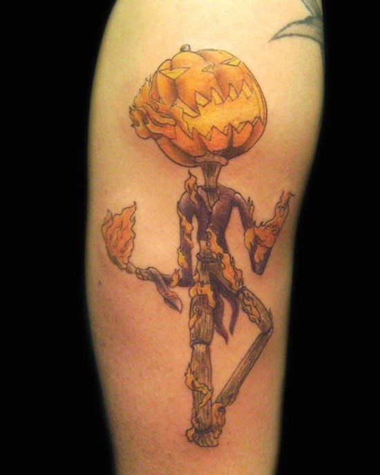 Cool designed and colored big monster pumpkin head monster in flames tattoo on arm